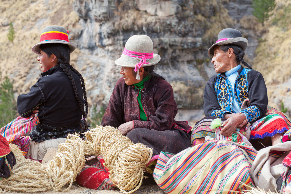 Local women at the Q'eswachaka Bridge Building Festival, Peru by Geraint Rowland Photography