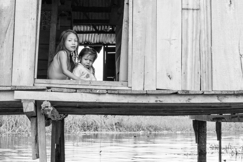 Black and white candid family portrait in Iquitos, Peru.