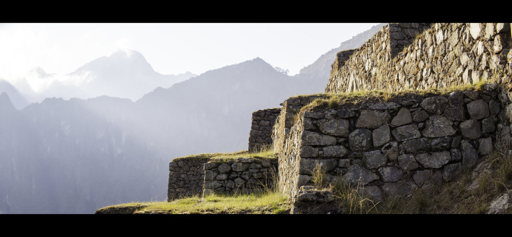 A cinematic photo of Machu Picchu in South America.