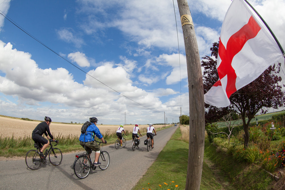 Cycling past an English Flag.