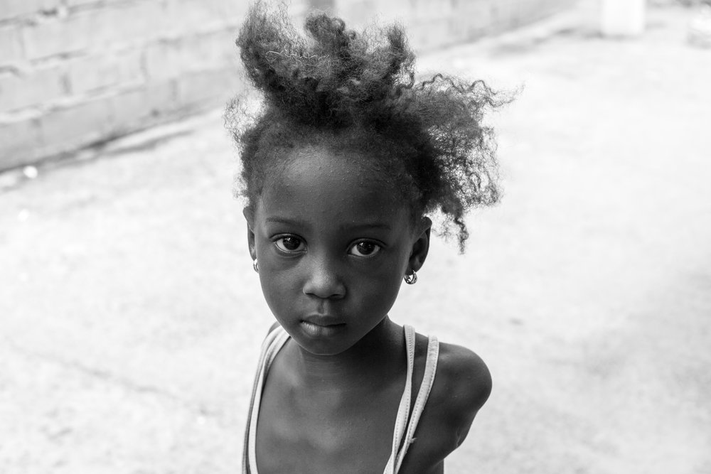 A beautiful black and white portrait of a young girl in Gambia.
