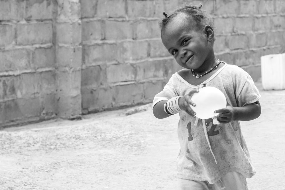 A cheeky Gambian child smiles for the camera.