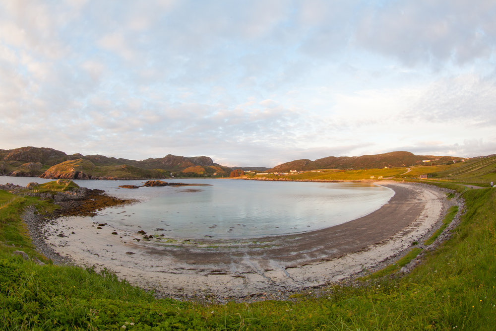 A fish eye capture of a circular beach in Scotland.