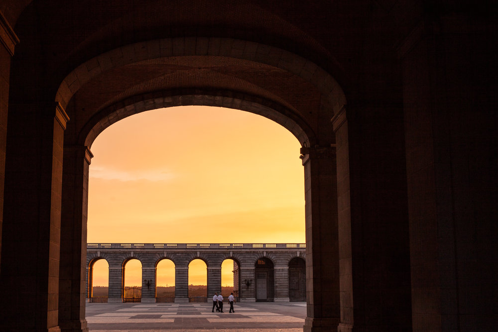 A frame within a frame, a sunset viewed through the archway of the palace in Madrid.
