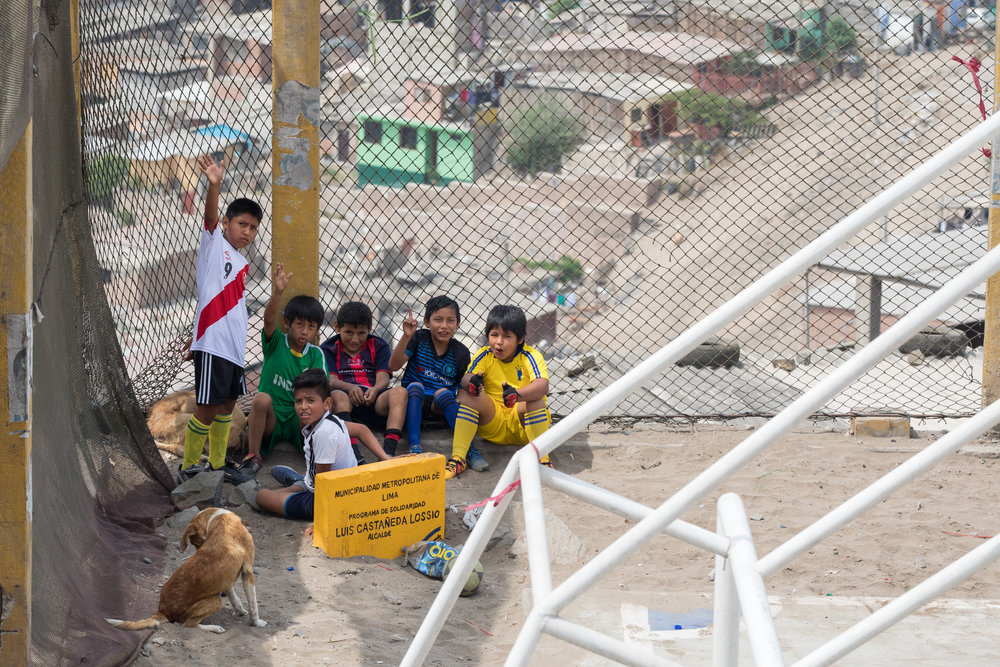 Peru's future football stars taking a break from the game in San Juan de Miraflores, Lima, Peru.