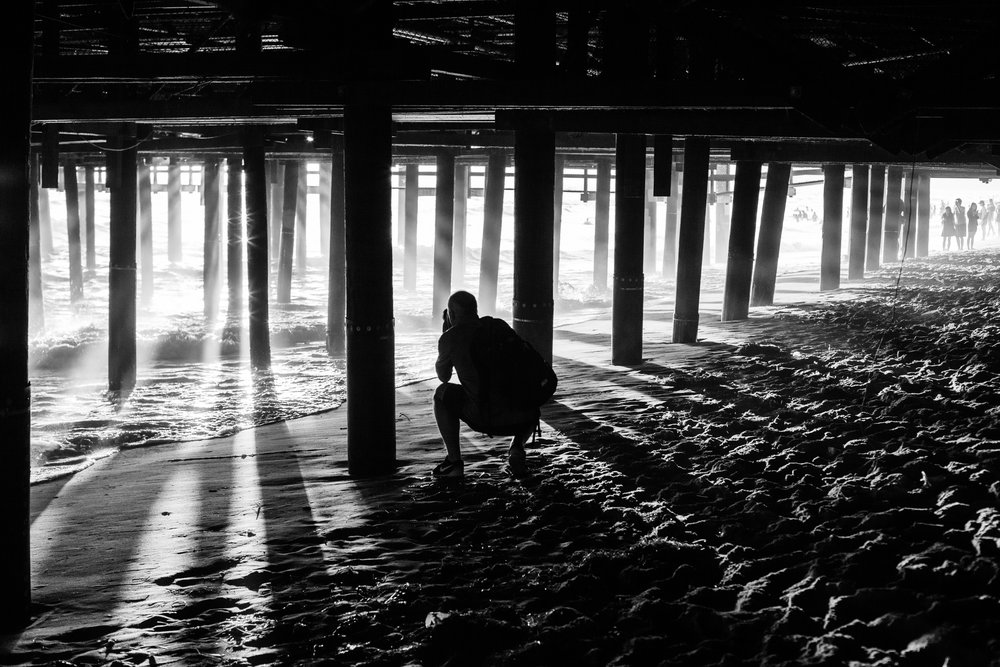 The light under Santa Monica Pier, California by Geraint Rowland.