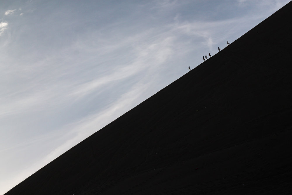 Heavy use of negative space and minimalism add to the scale of this photo in Huacachina, Ica, Peru.