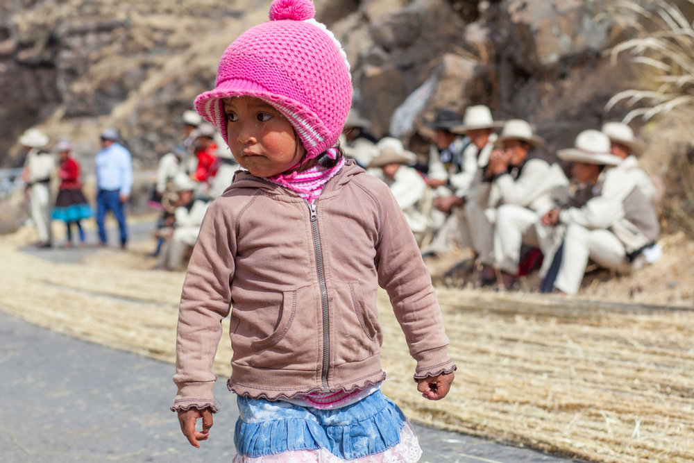 A Peruvian child with pink at The Q'eswachaka Bridge near Cusco.