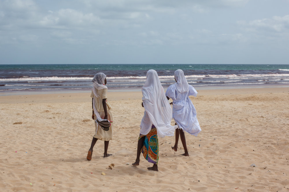 Muslim Girls on a beach in Senegal.
