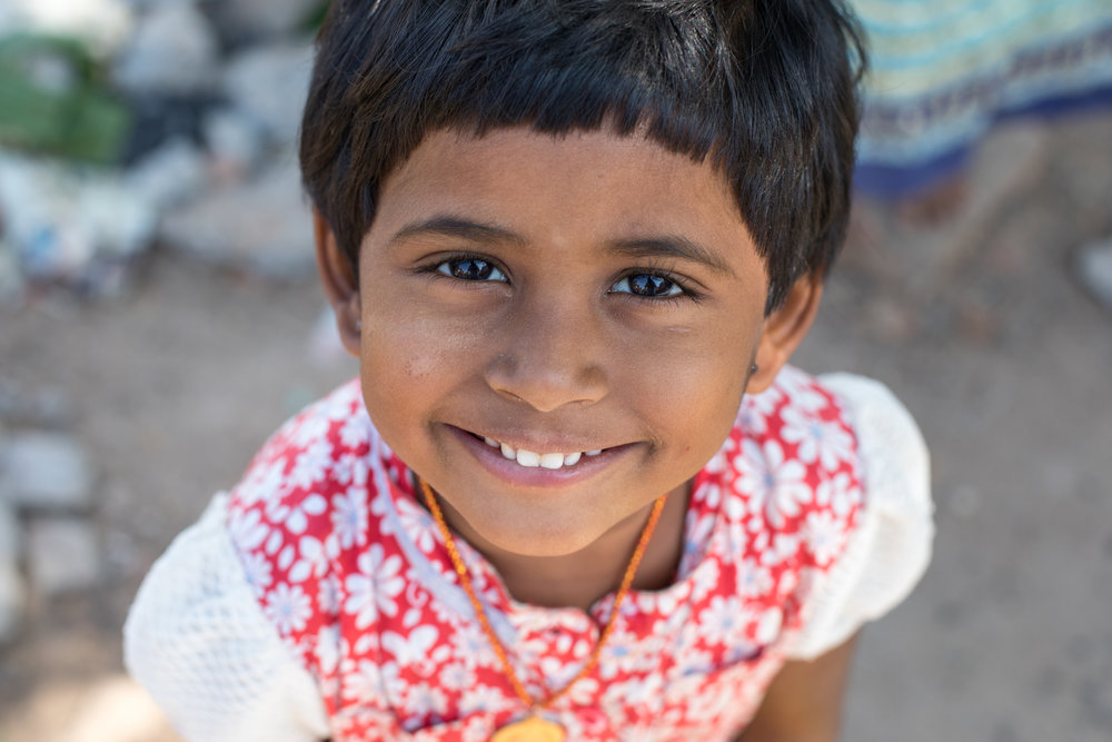 Portrait of a smiling Indian girl in Madurai.