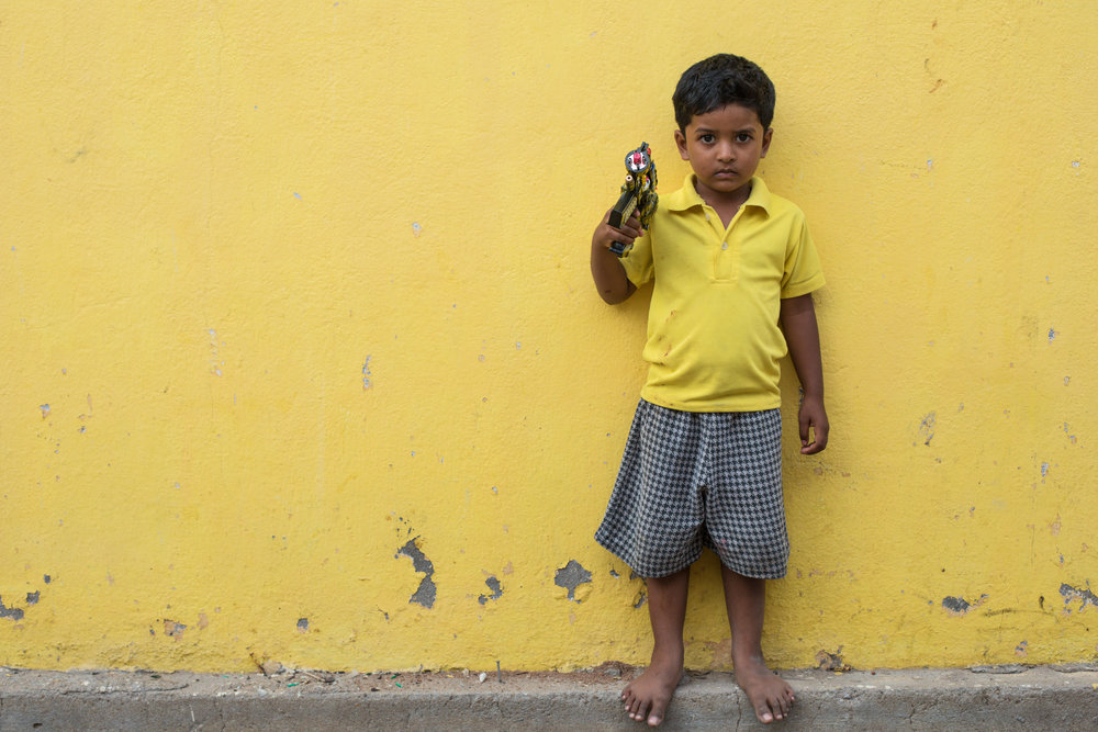 Yellow street portrait in Pondicherry, India.