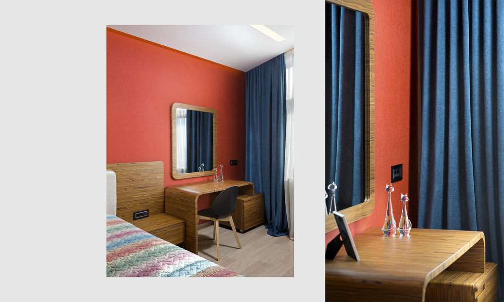 Corner dressing table. Colored walls in the bedroom.