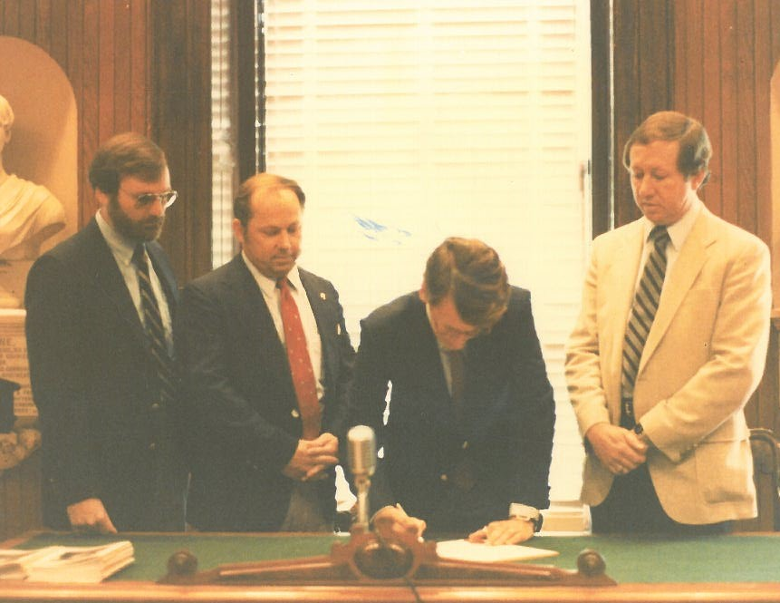 Mayor Joe Riley with some of the charter members signing the SCSPLS Coastal Chapter into order (1980)
