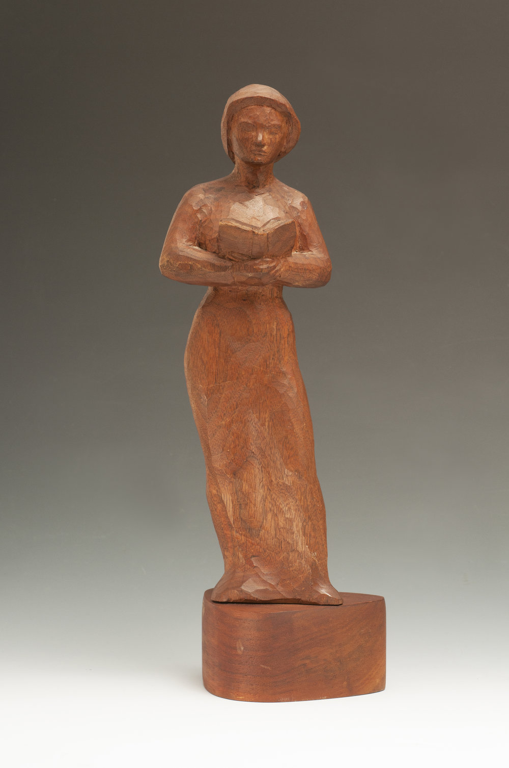 Emil Milan ,  Woman with a Book . Hardwood. 12 x 4 x 3 in.Collection of Moderne Gallery. Artwork appears in  Emil Milan: Midcentury Master .