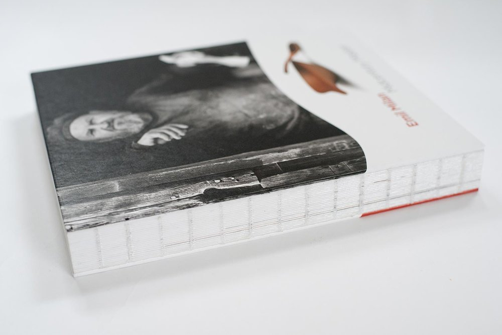 Exposed, thread-sewn binding that allows the book to lay virtually flat