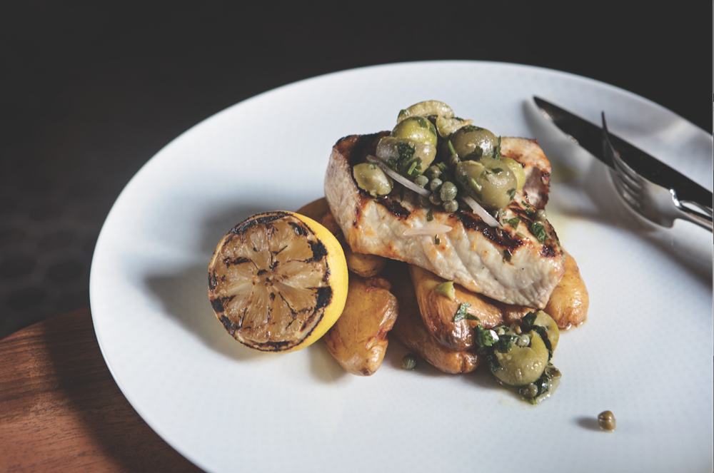 grilled  swordfish  with  castelvetrano  olives, roasted lemon, parsley and crispy fingerlings