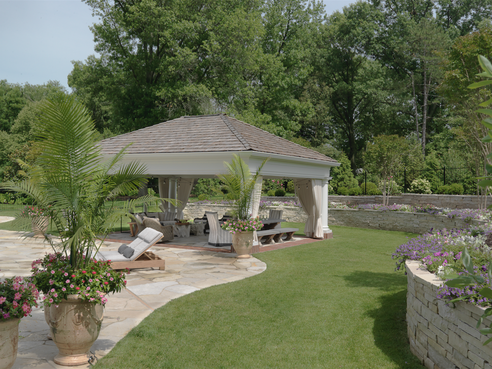 """The house sits on four acres. The pavilion wasn't in the original plans but was added six months in """"to make the property more cohesive,""""says the homeowner."""