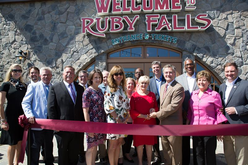 Ruby Falls President Hugh Morrow is joined by officials, members of the Steiner and Lambert families, and Tennessee Dept. of Tourist Development Commissioner Kevin Triplett to cut the ribbon on opening day of the new venues.