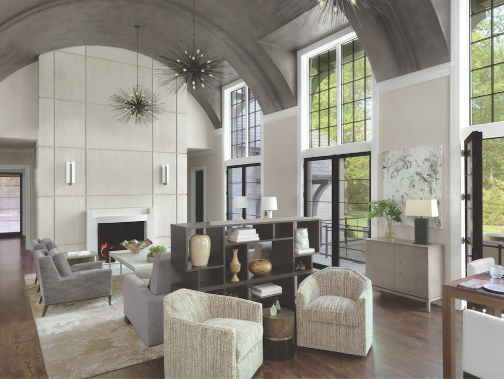 Proof that neutrals can be dramatic. The barrel-ceilinged gathering room, with a conversation grouping, hidden television, and casual dining space, is the center of the home.