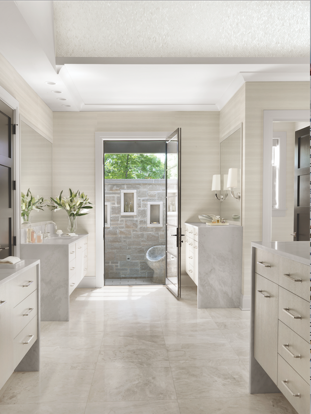 The master bath is outfitted with a standing-height vanity, abundant storage and a walled terrace complete with outdoor shower.