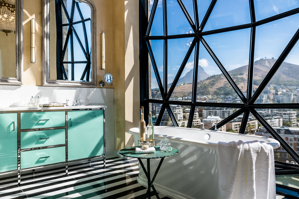 A deluxe superior bathroom inside The Silo Hotel at the Victoria and Alfred Waterfront in Cape Town.