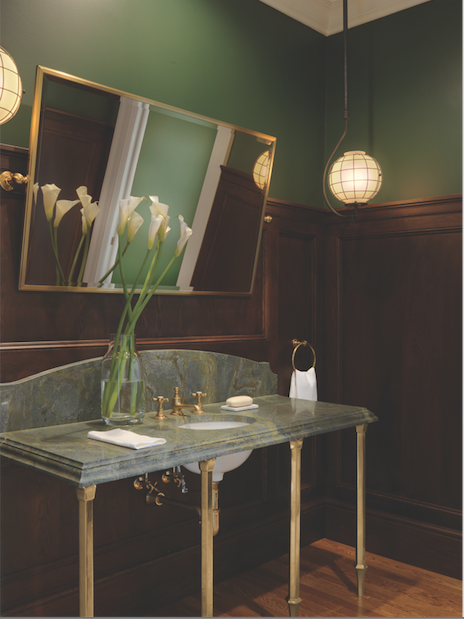Dark paneling lends an authentic touch to the third-flood bath adjoining the British pub.