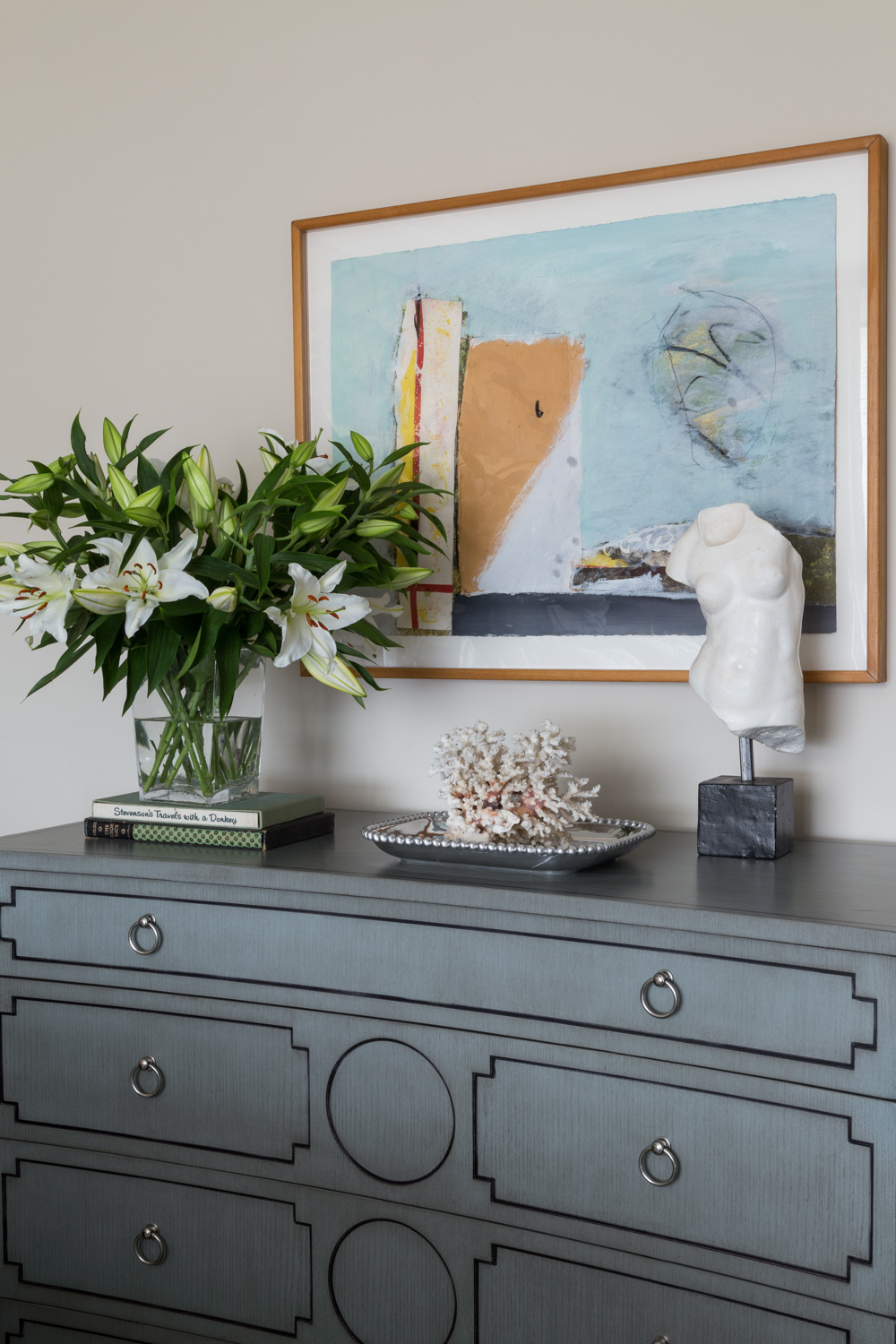 vignette of dresser with contemporary art