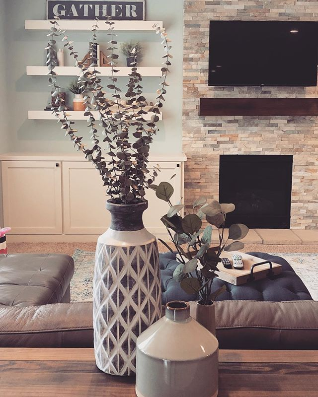Paint, a few new accent pieces and a boat load of accessories can completely change the feel of a room. #lightandairy #interiordesign #michiganinteriordesigner #interiors #furniture #newpaint #benjaminmoore #accessorize #eucalyptus #grandrapidsinteriordesign #shelfie #whiteandwood #quietude #texture
