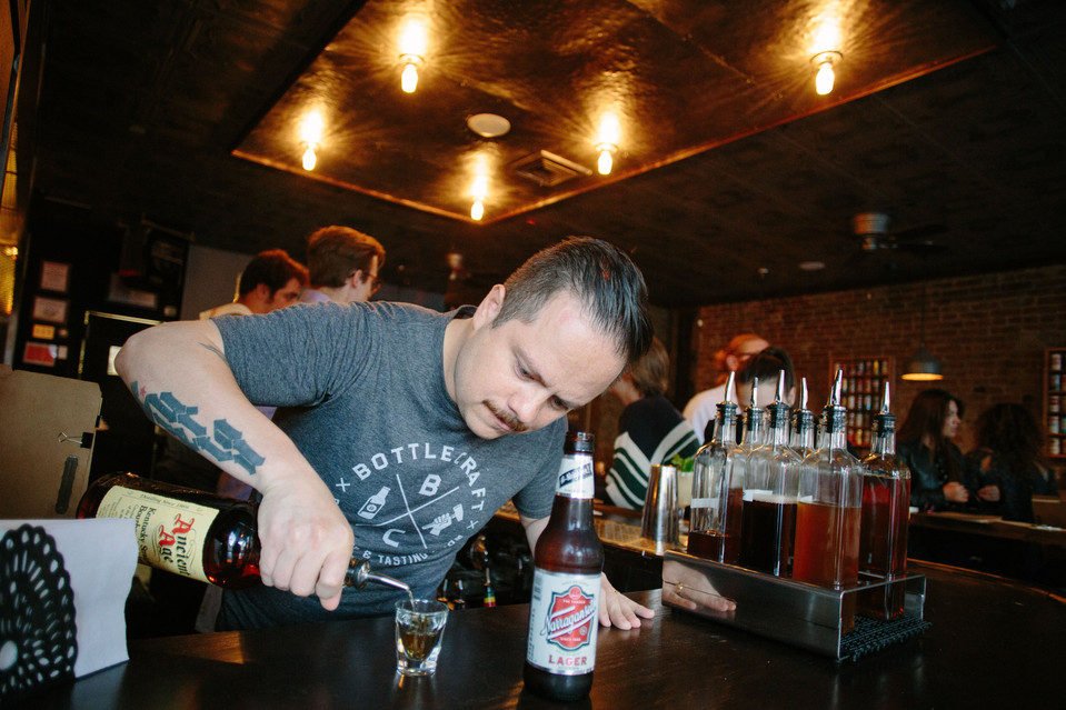 Erick Castro pours up drinks at the Boilermaker. RAMSAY DE GIVE FOR THE WALL STREET JOURNAL