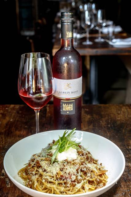 A rosé paired with the spaghettini with Cincinnatus' chili, cranberry beans and aged cheddar at In Vino. PHOTO:BRYAN THATCHER