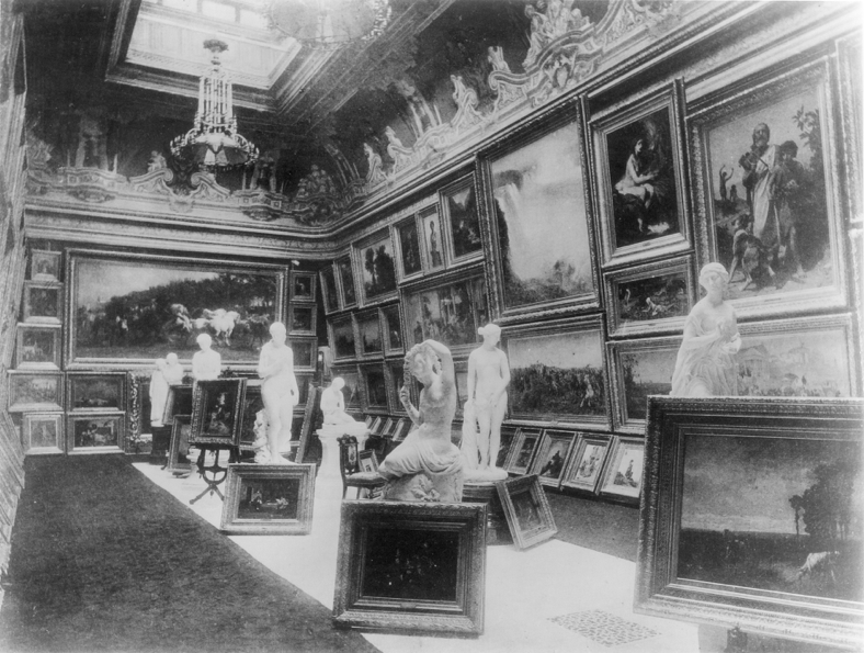 View of the Picture Gallery in A. T. Stewart's Marble Mansion at Fifth Avenue and 34th Street.  Gérôme's  A Collaboration  can be seen at the center left on the floor.  To its right is Hiram Power's original  Greek Slave  (now Yale University Art Gallery) above which hangs Frederick Church's  Niagara Falls from the American Side  (now Edinburgh, National Gallery of Scotland).  Rosa Bonheur's  Horse Fair  (now Metropolitan Museum of Art) hangs on the end wall.