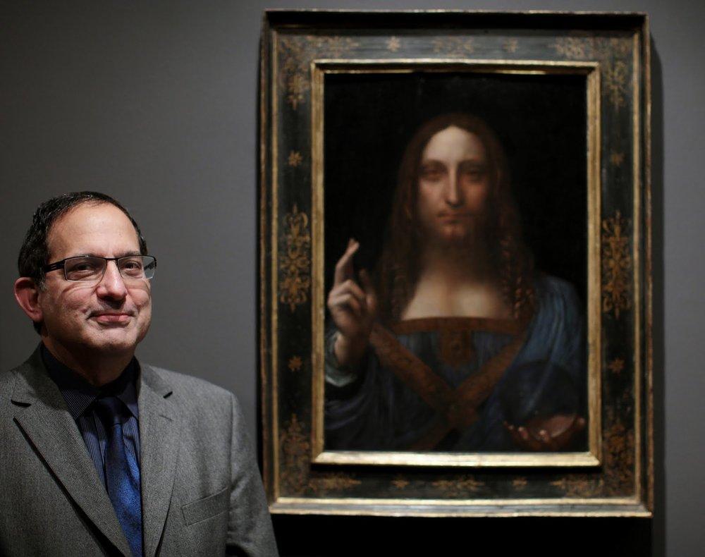 Robert Simon with Leonardo's Salvator Mundi.