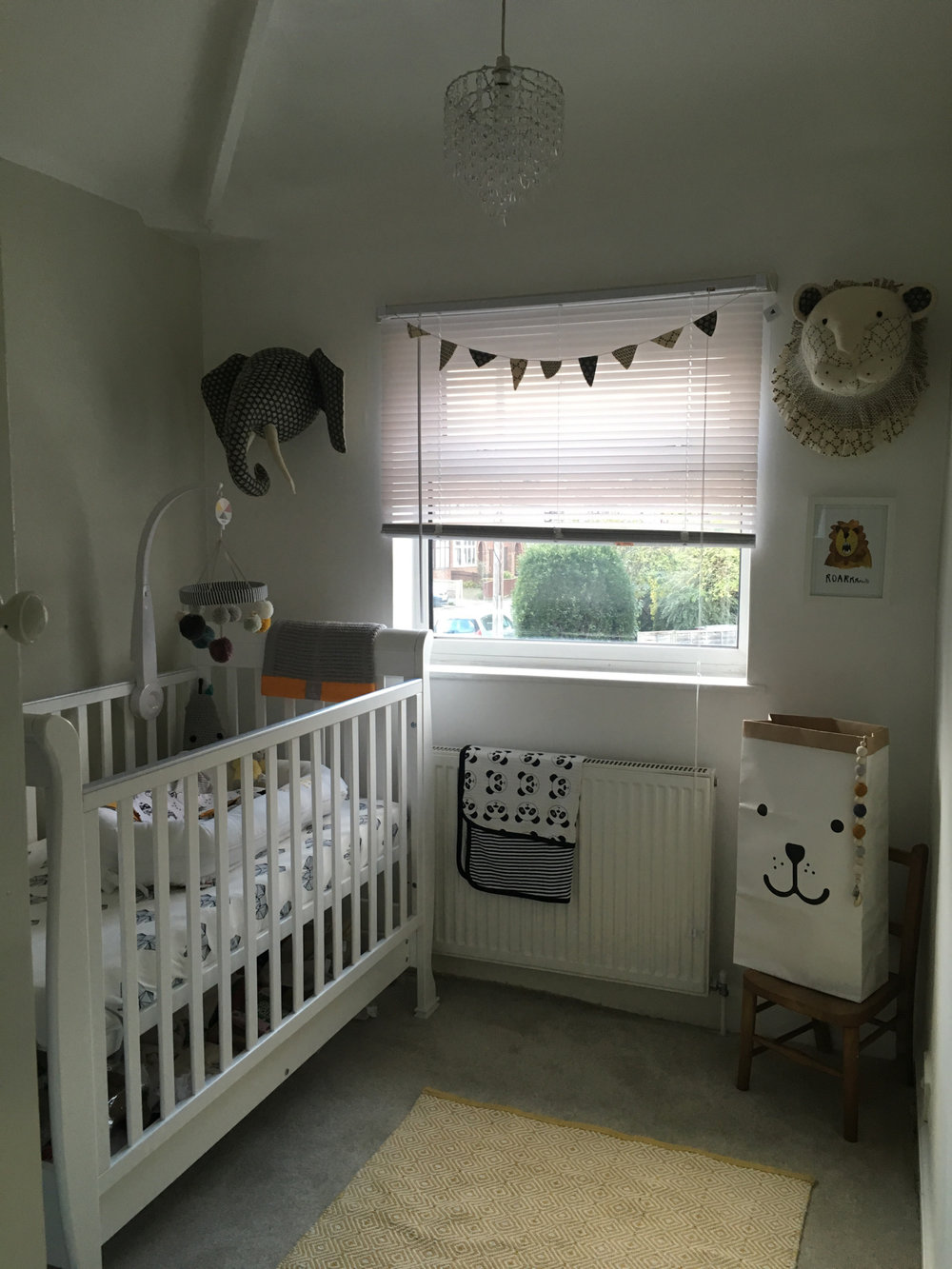 Changing mat, rug and pom pom mobile all from  Mamas and Papas.