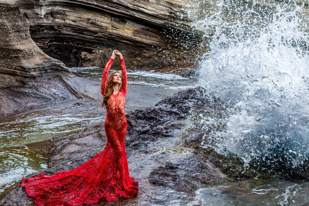 Glamour Model in Hawaii designer red dress in Honolulu Lava Tube - Hawaii Glamour Photographer - Waimanalo beach photography - Premier Modeling Agency - Ketino Photography.jpg