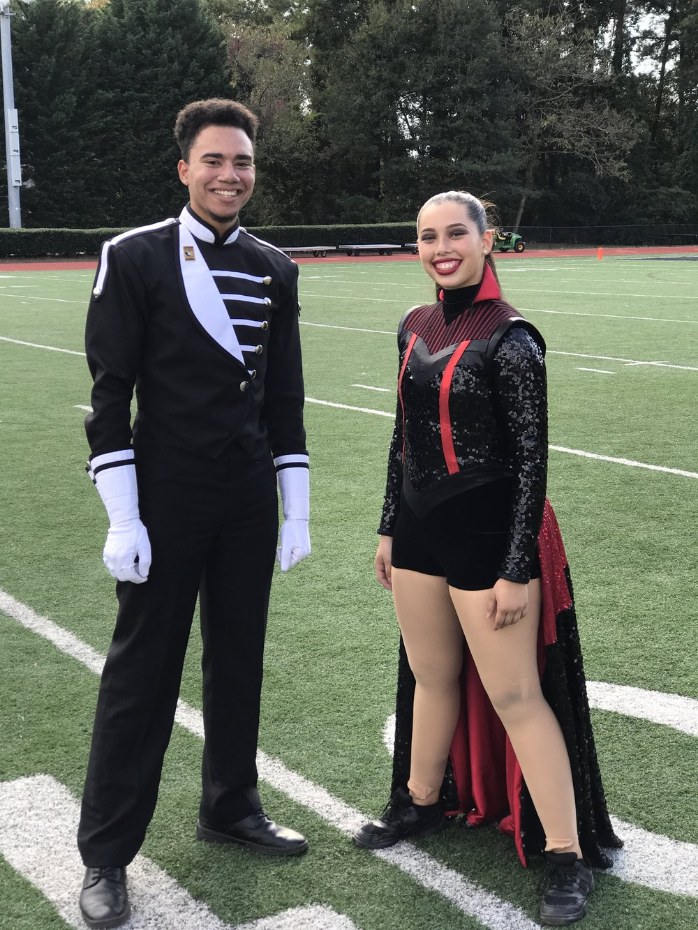 Seniors Astrid Garavis and Ty Scott. Recipients of the QuestBridge Academic Scholarship. Participated in all four years of band and colorguard.
