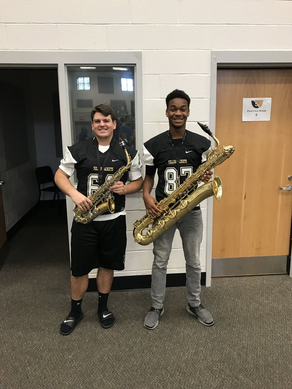 Varsity football Players Jordan Woods and Cooper Dickenson are members of the Advanced Concert band.