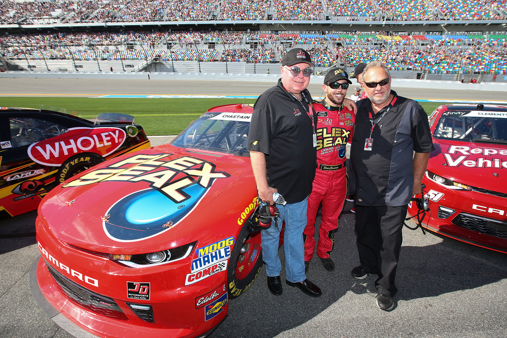 Gary Keller (left) with driver Ross Chastain (center) and business partner Johnny Davis (right)