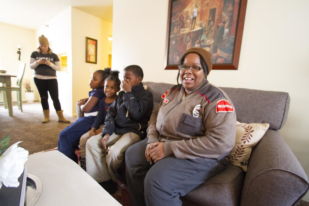 Lamanda Brown, 29, with her children in their home, designed by Humble Design.