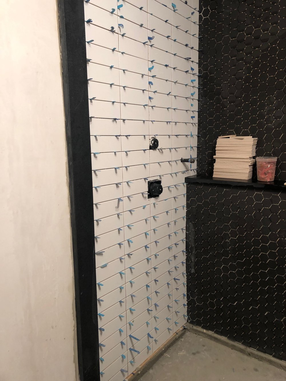 Gray Oak Studio - Wednesday Five - stacked white subway tile wall