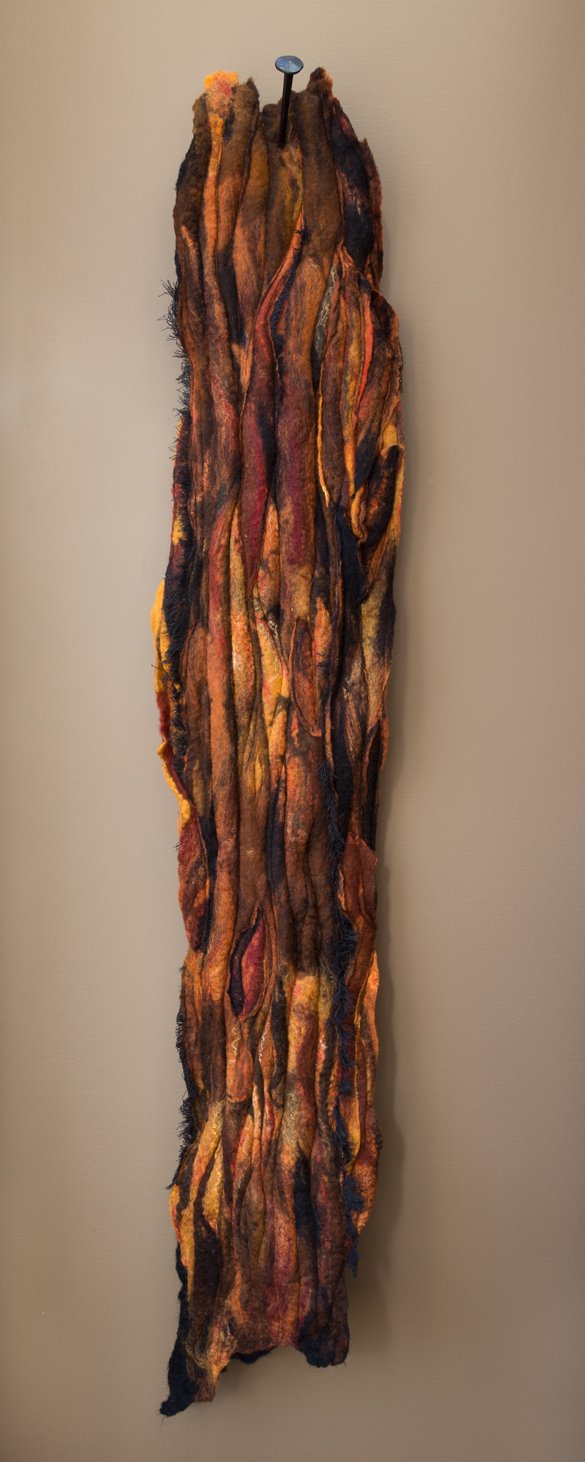 burnt   handmade felt, mixed media  52 x 10 x 5