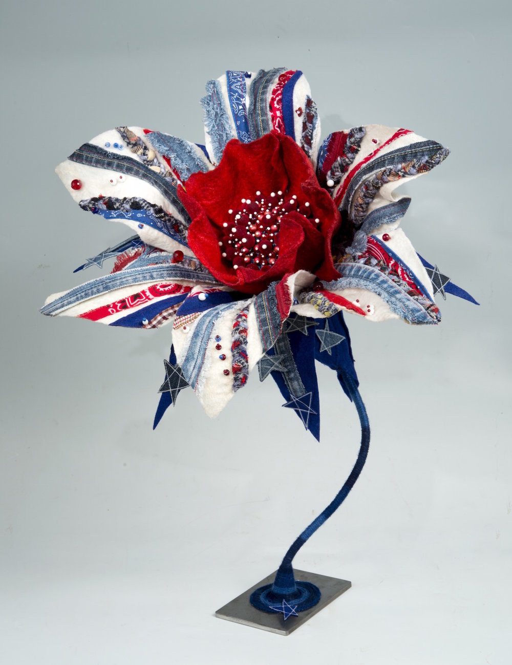 genetically designed flower:  daisy 'americana' handmade felt, mixed media 25 x20 x19