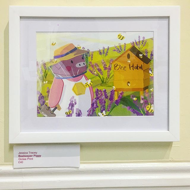 Ta-dah! Here's Beekeeper Piggy looking pretty at his very own exhibition! 🐝This print is available to buy, and printed by the lovely @justgiclee whom were incredibly helpful and kind. 100% recommend for all of your printing needs!  #beekeeping #beekeepinglife #illustration #illustrationhowl #illustrationdaily #exhibition #artexhibition #illustrationexhibition #kidlit #kidlitart #cuteart #foodart #digitalart #nuneatontown #nuneatonandbedworth #nuneatonmuseumandartgallery #giclee #gicleeprint #illustchu