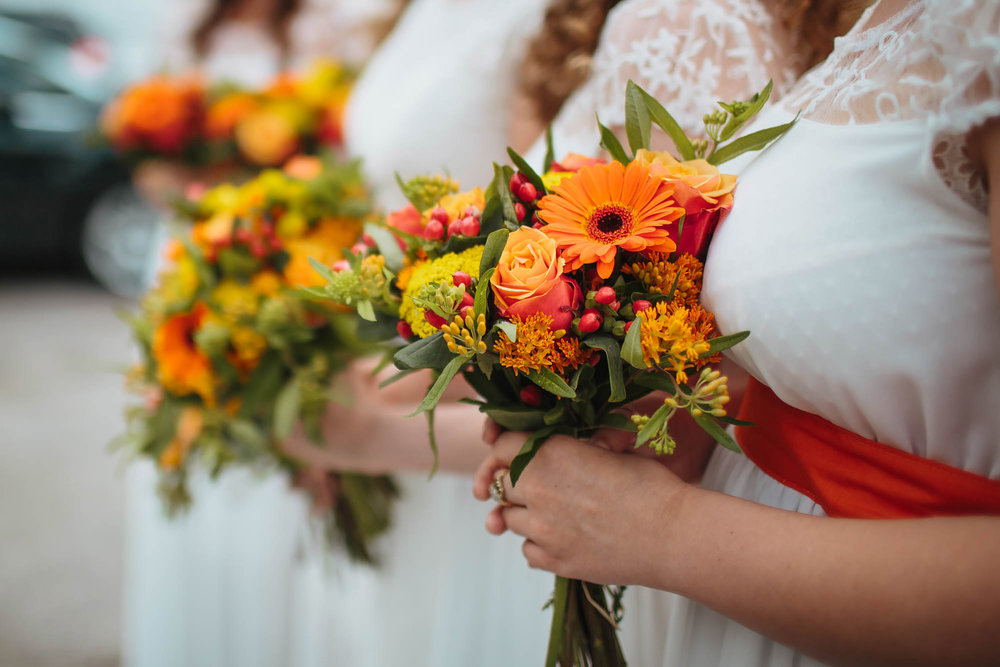 Bridesmaids hold their bouquets at a wedding in Yorkshire