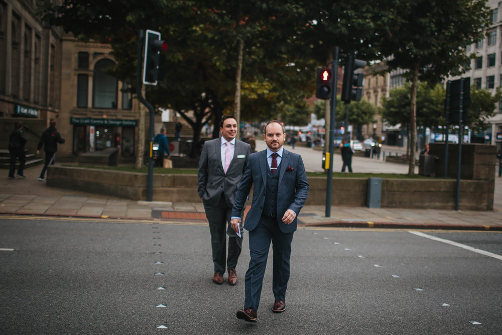 Groom walks to his wedding at Leeds Town Hall