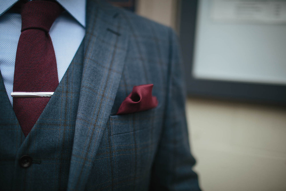 Close up of the grooms suit at Leeds City Centre
