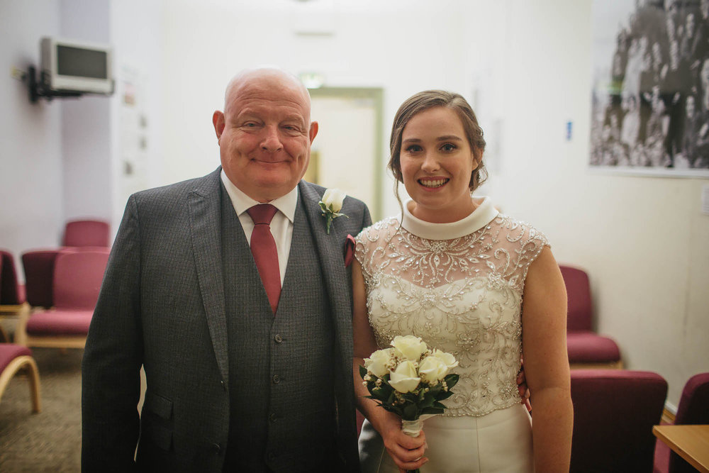 Bride and her father at a wedding in Leeds Town Hall
