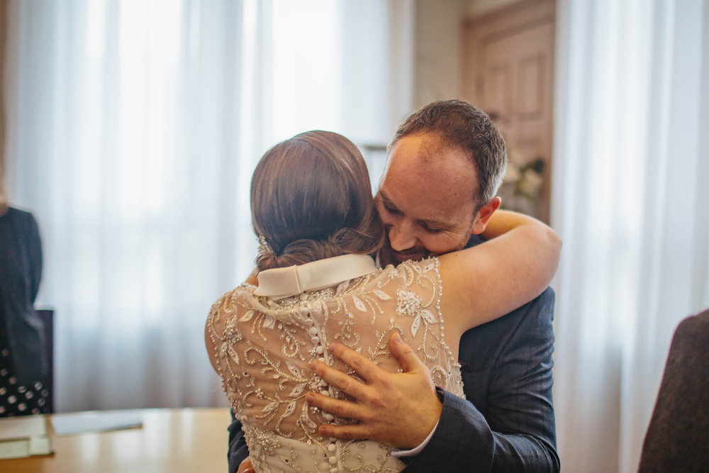 Leeds Yorkshire Wedding Photographer Hug Bride Groom