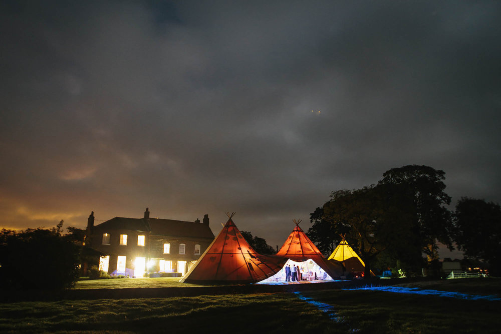 Night time photo of Hornington Manor and tipi at a wedding in Yorkshire