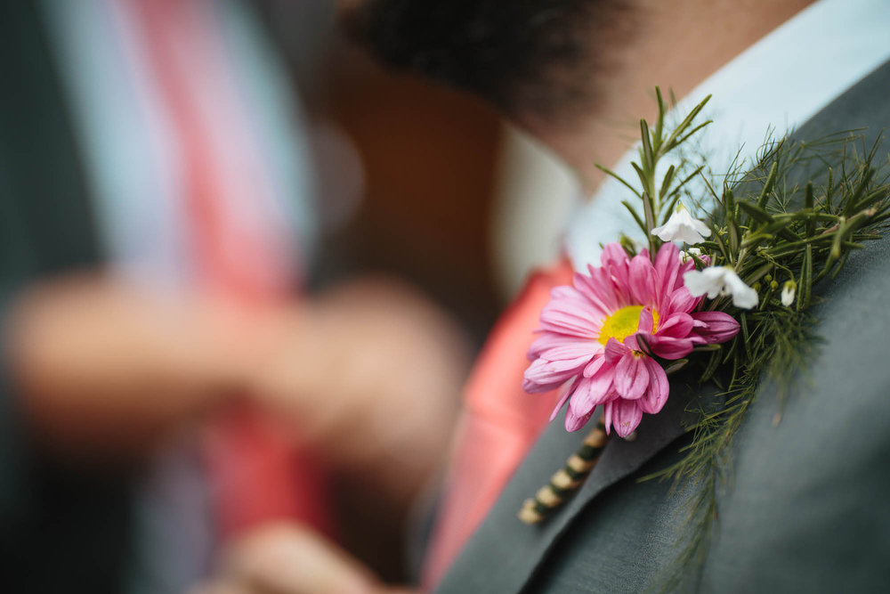 Close up of the wedding flowers as a buttonhole