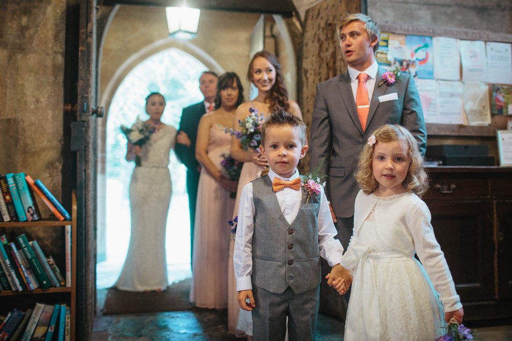 Boy and girl holding hands at a church wedding